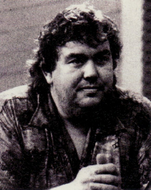 The rugged look of John Candy.