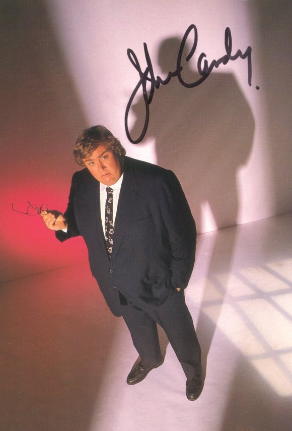 A popular John Candy signed photograph.